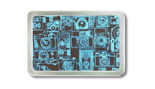 Gürtelschnalle mit gezeichneten Fotoapparaten